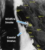 A wildfire ignited at a Fort Hunter Liggett Army firing range and consumed 5,000 acres of grassland before it was contained today. The blaze was so big, you could see it from space! National Weather Service photo shot by satellite.