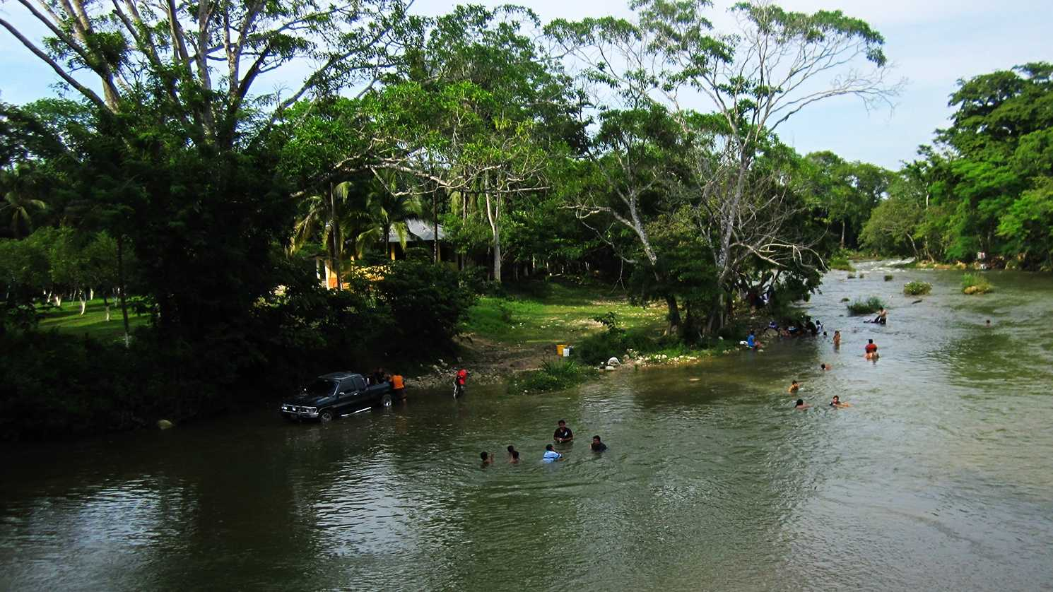 Local kids play in a river on the border of Guatemala and Belize.
