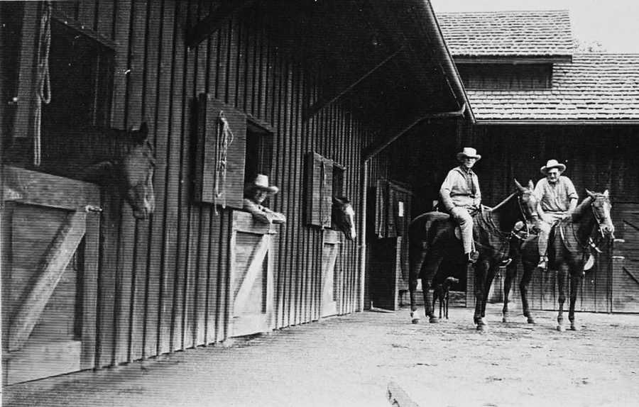 Horses are seen here at the barn in the 1930s.