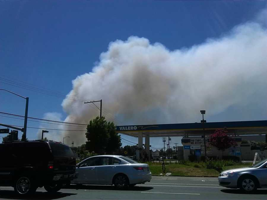 A four-alarm grass fire is kicking up a large amount of smoke in and around Cal Expo on Friday afternoon.