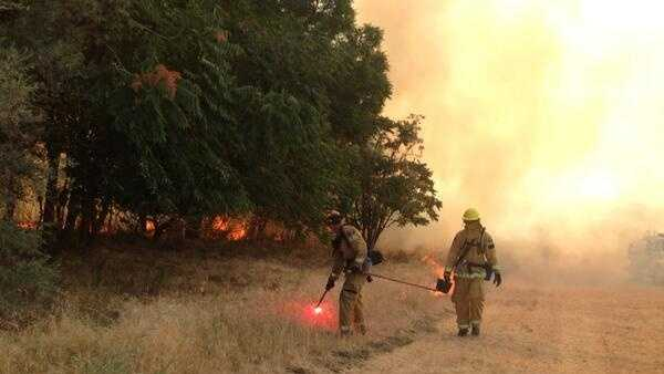 Grass fire near Cal Expo prompts evacuations