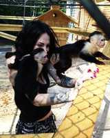 Tichelman is seen playing withDean Riopelle's pet monkeys.