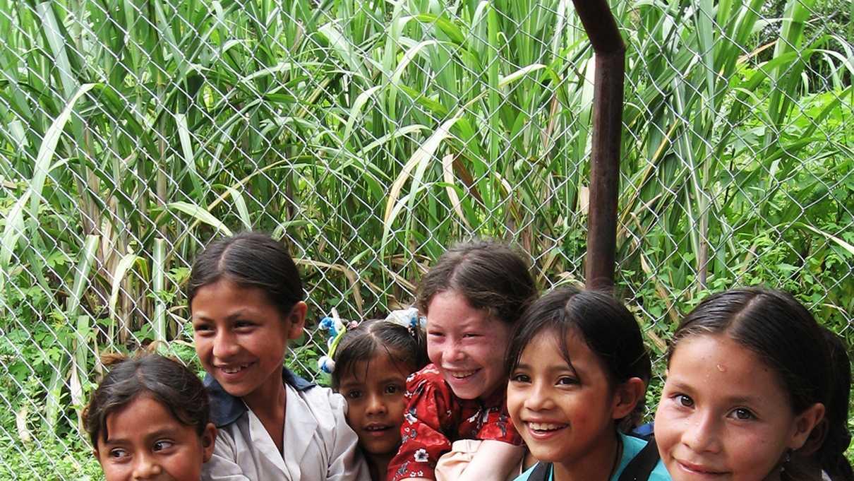 Girls plays with water at a school inHonduras.