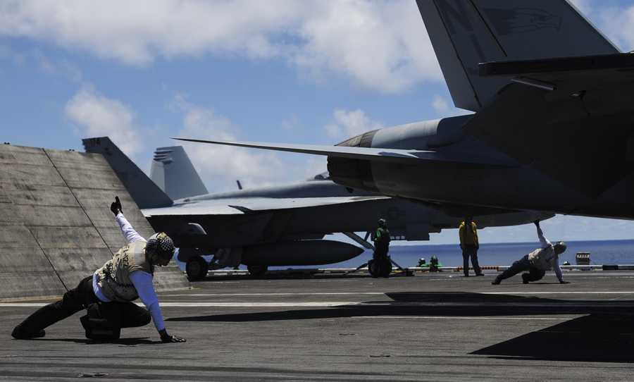 The USS Nimitz is more than 1,000 feet long, has a 252-foot-long flight deck, weighs more than 100,000 tons, and can hold 80 helicopters and jets.