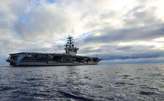 Navy Lt. Cmdr. Clint Phillips said the aircraft carrier was anchored five miles offshore so that it would not startle local boaters and impact local boat traffic.