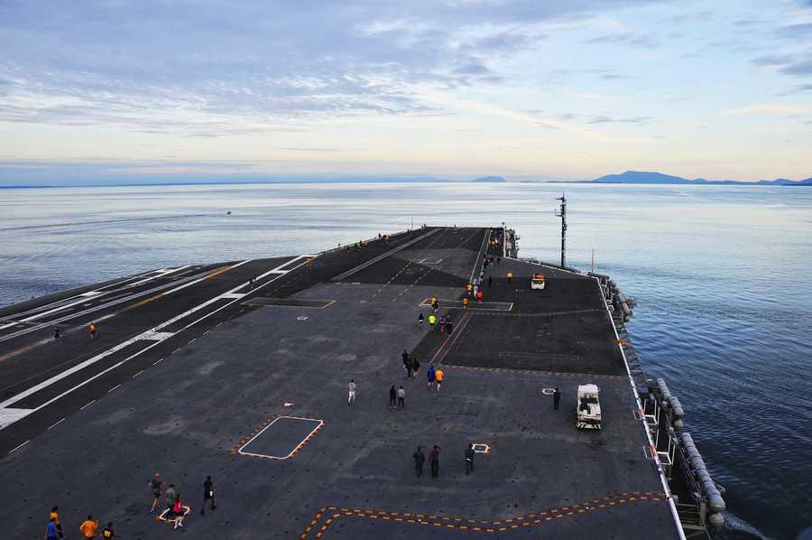 A massive Navy aircraft carrier, the USS Nimitz, was anchored five miles southeast of Santa Cruz.