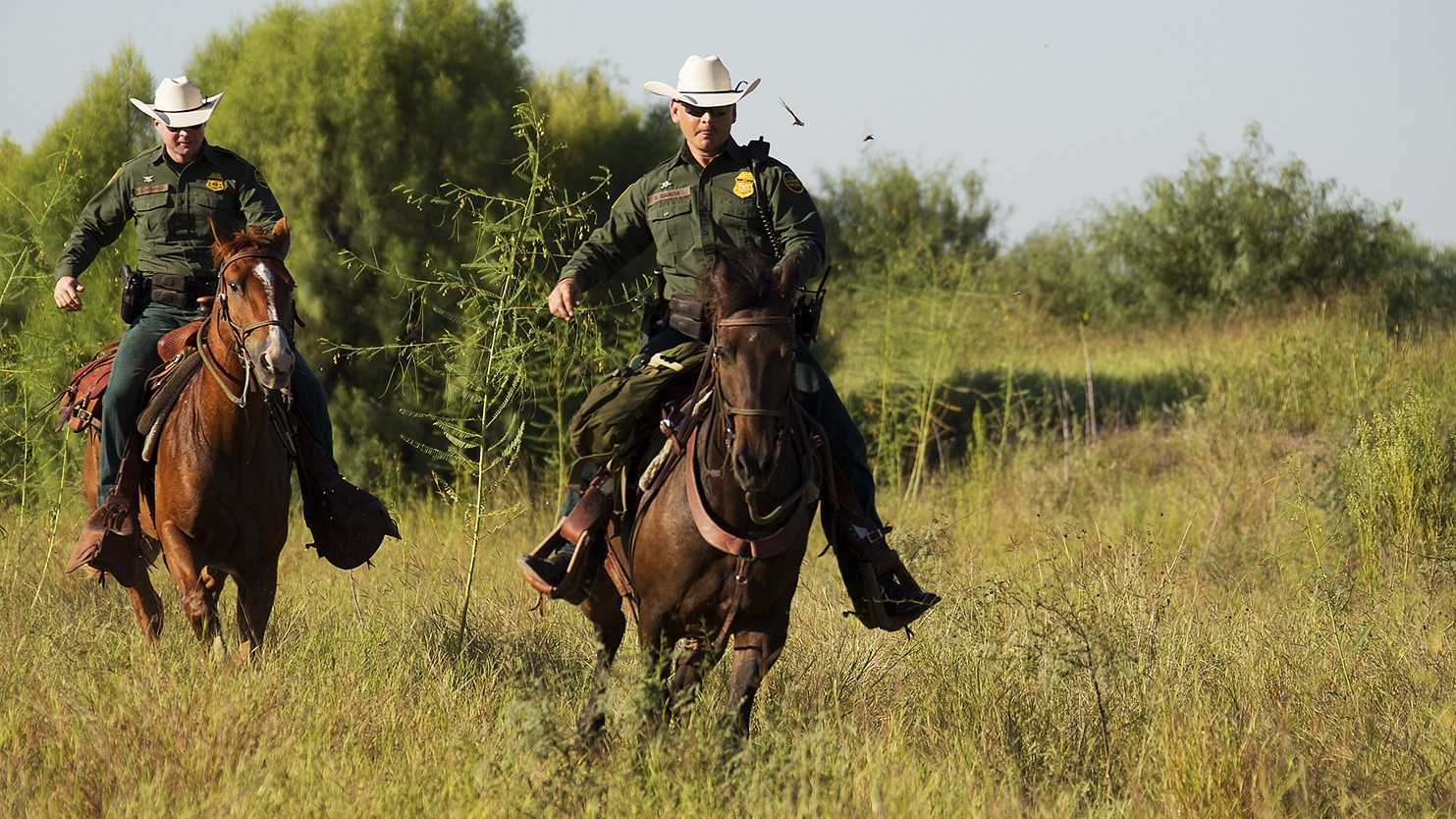U.S. Border Patrol agents patrol the Mexico-US border on horseback in south Texas.