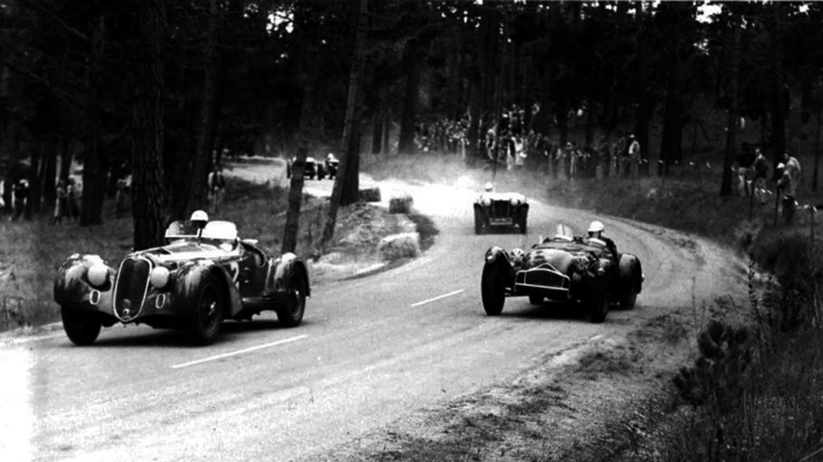 Racecar driving legend Phil Hill races an Alfa Romeo through the forests of Pebble Beach in 1951.