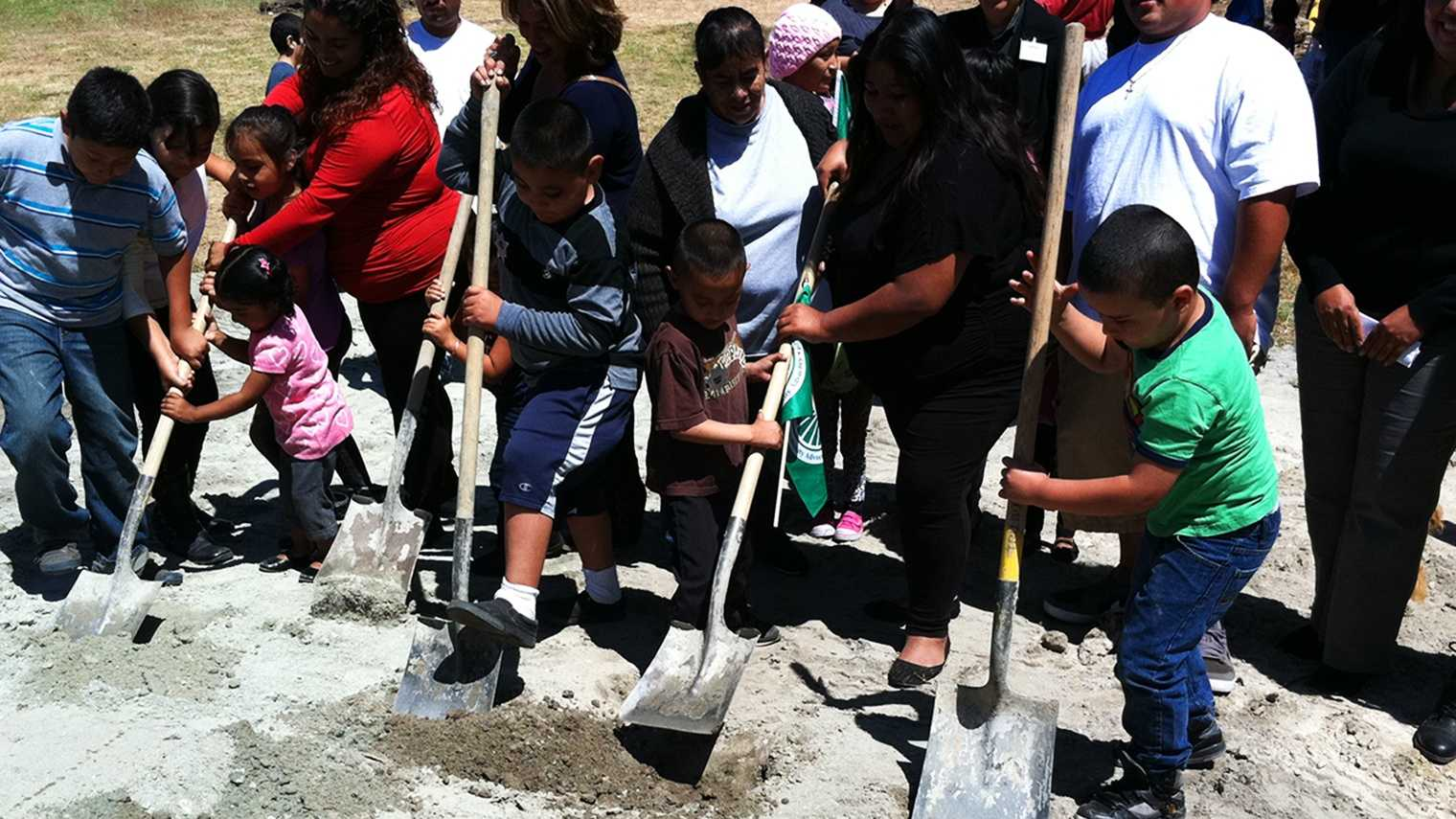 Kids break ground in Acosta Plaza for a new basketball court.  (Aug. 14, 2014)