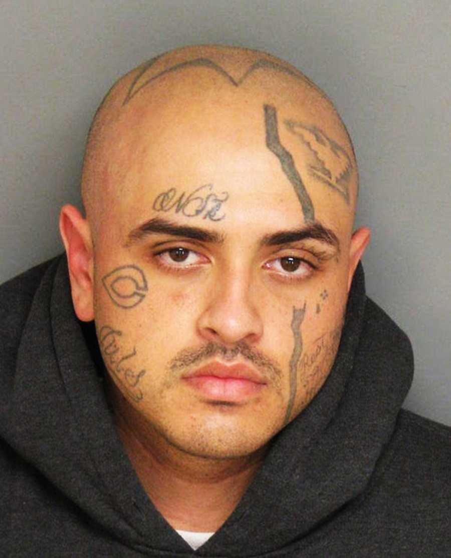 "Adali Mendoza, 29, is wanted by Salinas police after he was chased by officers from Salinas to Chualar and escaped by running across a ranch. He has several tattoos on his face including ""C"", ""Jules"" and ""NSK."" He also has tattoos of a huge star and a huelga bird on his head."