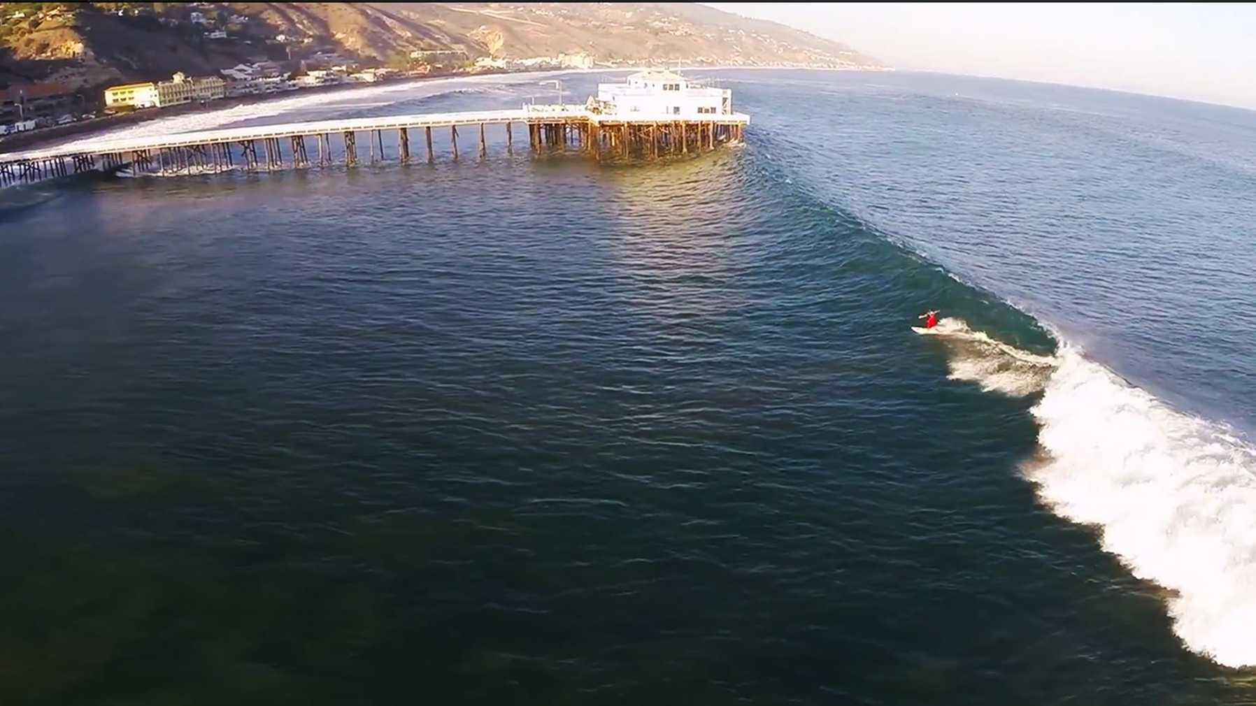 "A surfer ""shoots the pier"" in Malibu. (Aug. 26, 2014)"