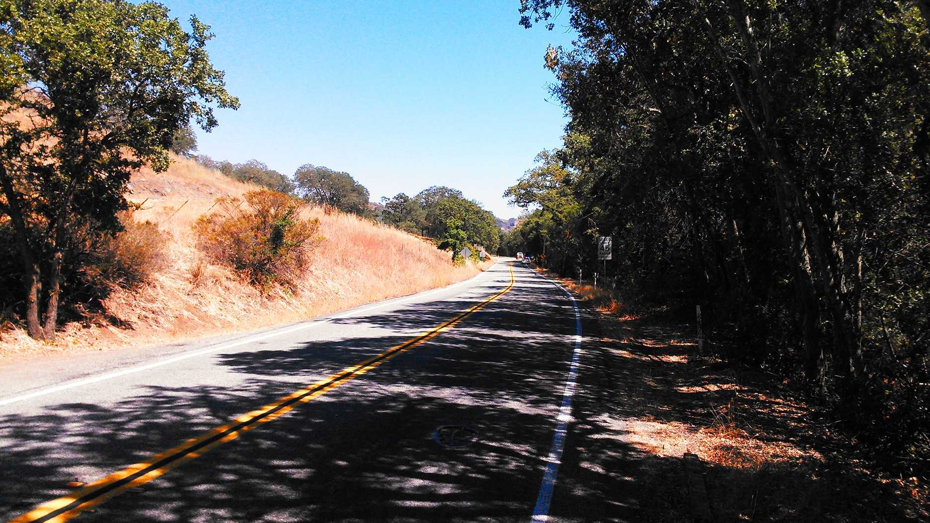 A burned body was found on this road outside Morgan Hill.  (Aug. 28, 2014)