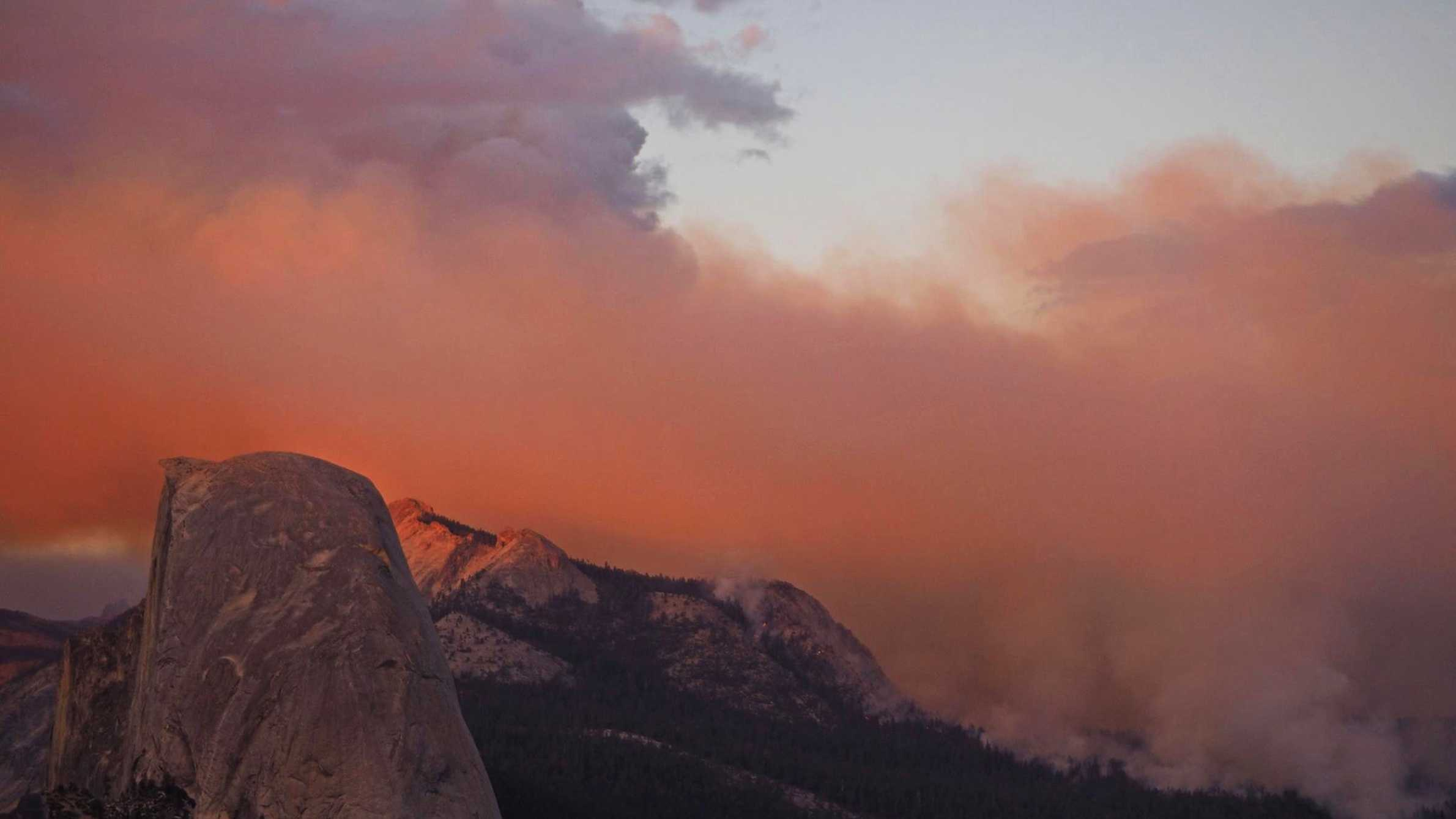 The fire sent smoke into Yosemite Valley, from where the park's famous high granite summits, Half Dome and El Capitan, are visible.