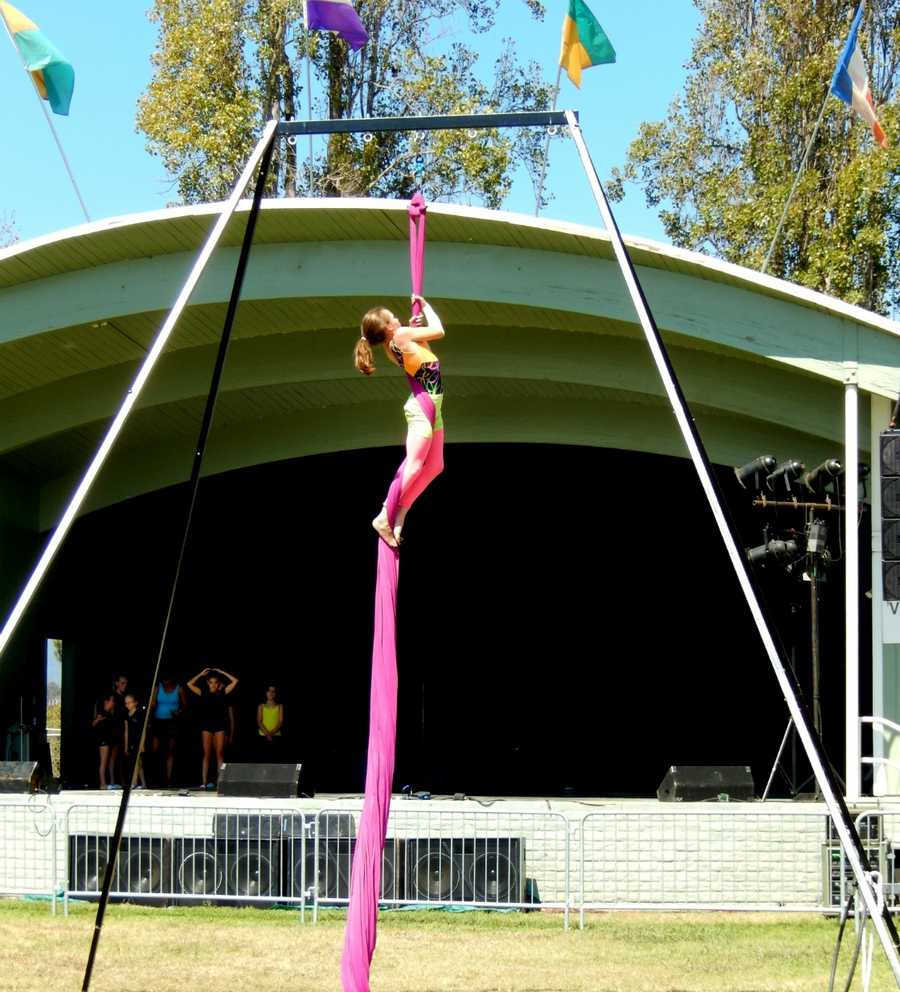 Sylvia, (seen climbing here), Corey, and Olivia performed at the fair in front of the bandstand.