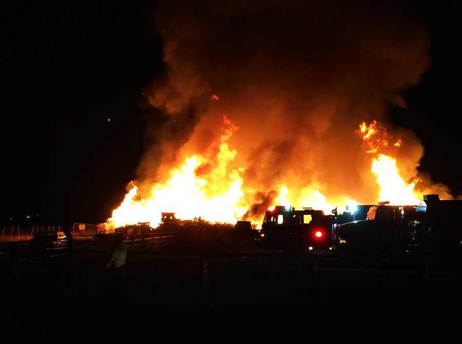 The fire ignited on a ranch along Ferguson Road. A barn, several vehicles, and piles of pallets were destroyed as the blaze continued burning for eight hours.