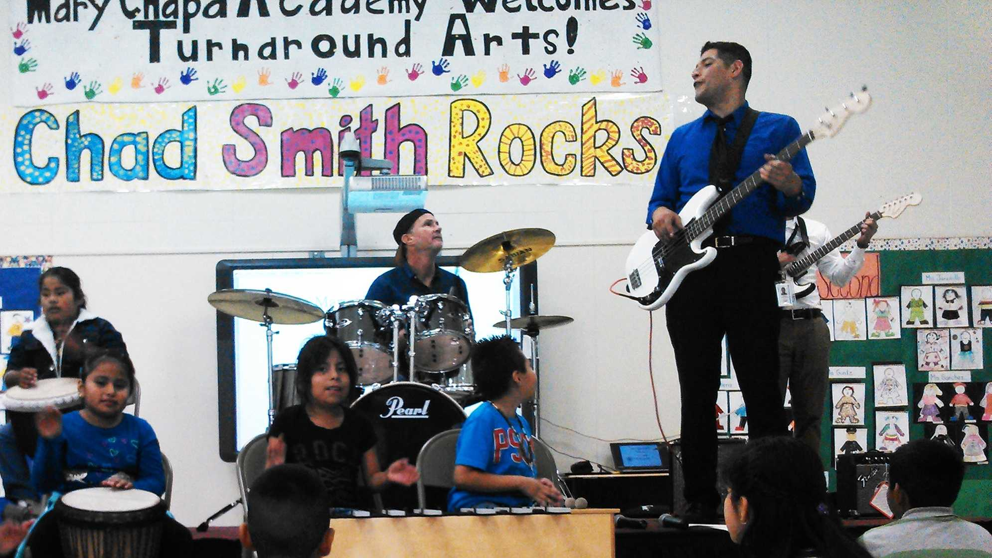 Chad Smith, Red Hot Chili Peppers drummer, plays at Mary Chapa Academy in Greenfield Thursday.