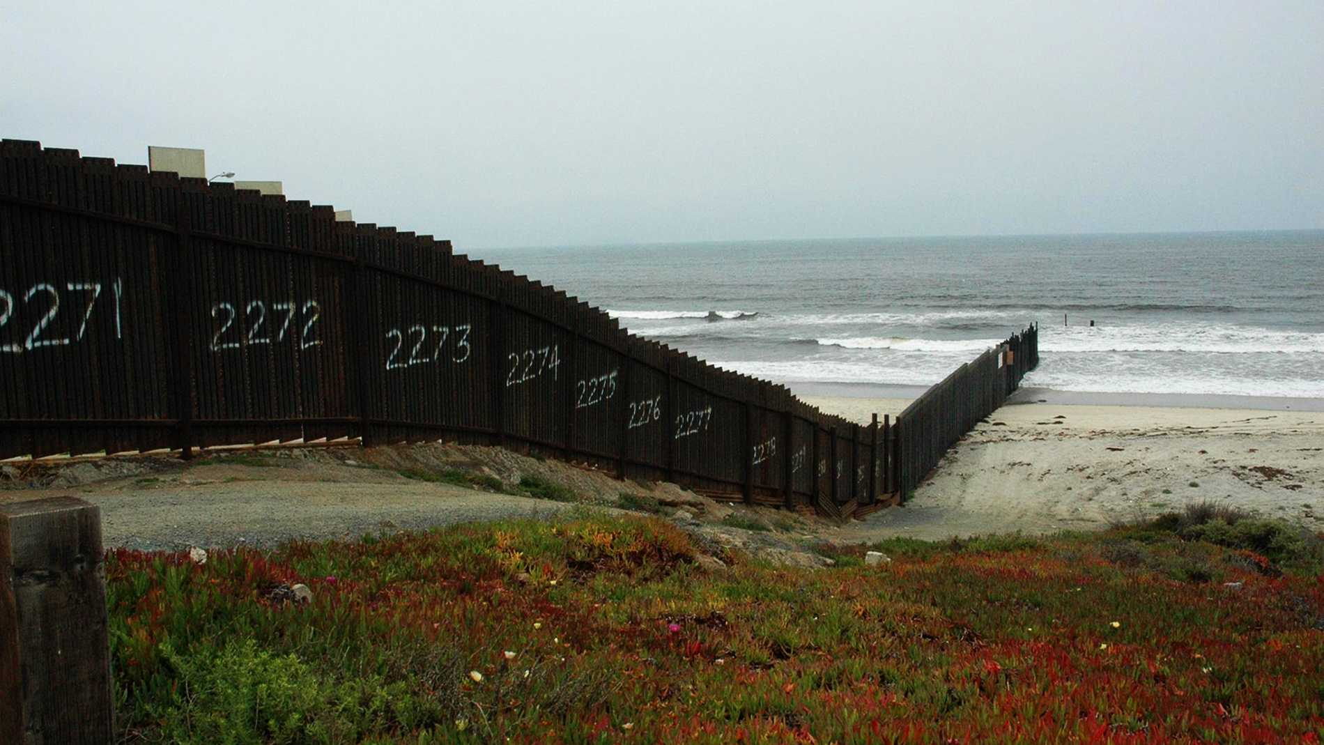Border Field State Park, California is seen. Playas de Tijuana, Mexico is on the other side of the border fence.