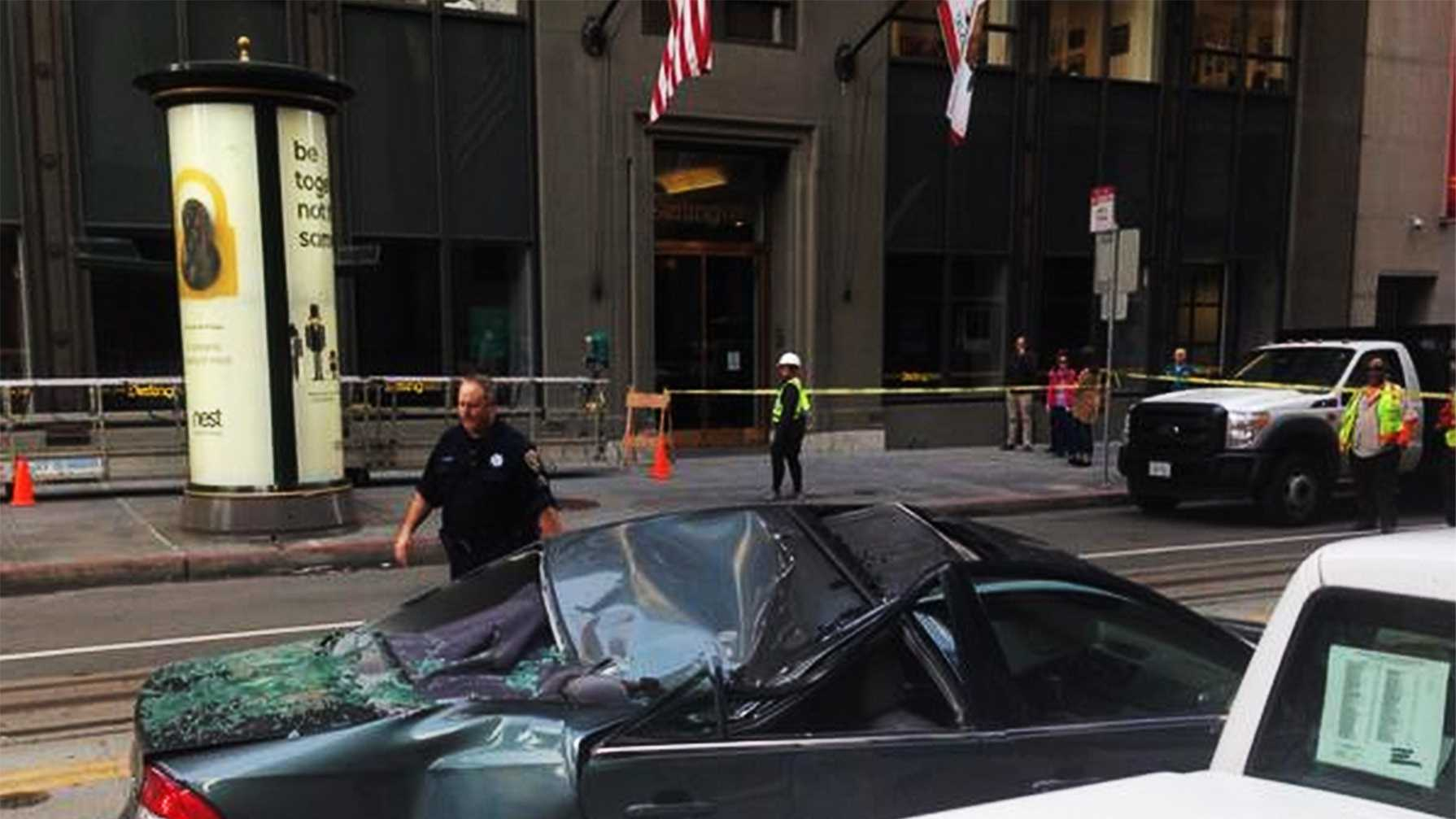 A window washer landed on this car in San Francisco.  (Nov. 21, 2014)