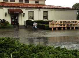 Downpours caused the area outside the Pacific Grove Post Office to fill with water. Dec. 11