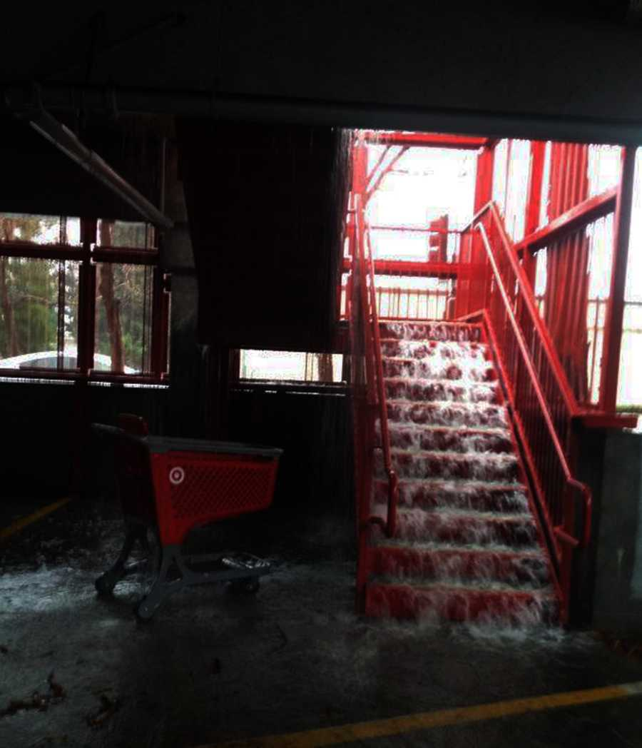 A parking structure's stairway by the Capitola Mall turned into a waterfall. Dec. 11