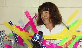 Eventually, Dorney was covered in so much duct tape, she was suspended half way up a wall.KSBW interviewed Dorney while she was attached to the wall.