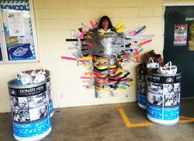In exchange for a $1 donation, students and faculty members were given 1 foot of pink, yellow, gray, and black Duct Tape to wrap around Principal Deborah Dorney.