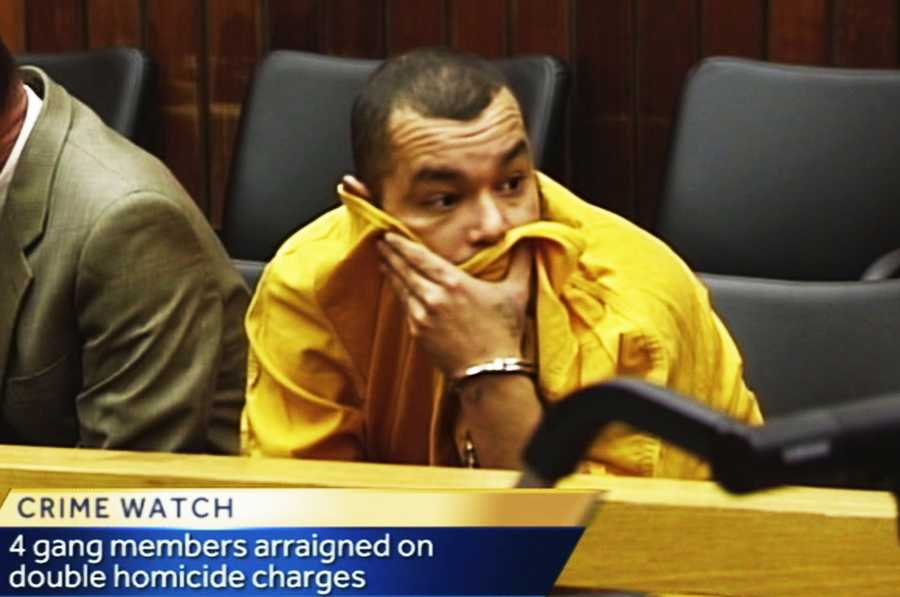 Jimmy Fernando Espinoza tried to hide his face during his first court appearance in Santa Cruz on Dec. 17.