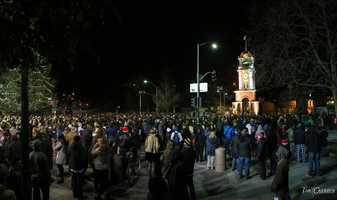 People wait for the Santa Cruz clock tower to strike midnight on New Year's Eve.