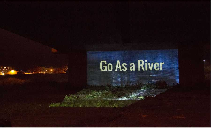 """Go As A River: Danielle Williamson for """"Go As A River"""" – This video projection, shown at night, encourages participants to come together to collectively ponder the future of water issues."""