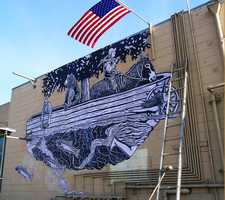 """Beaver Dam: Bridget Henry for """"Beaver Dam"""" – Black and white woodcut mural wheatpasted on the back of a building facing Front Street at the access point near Surfrider Cafe."""