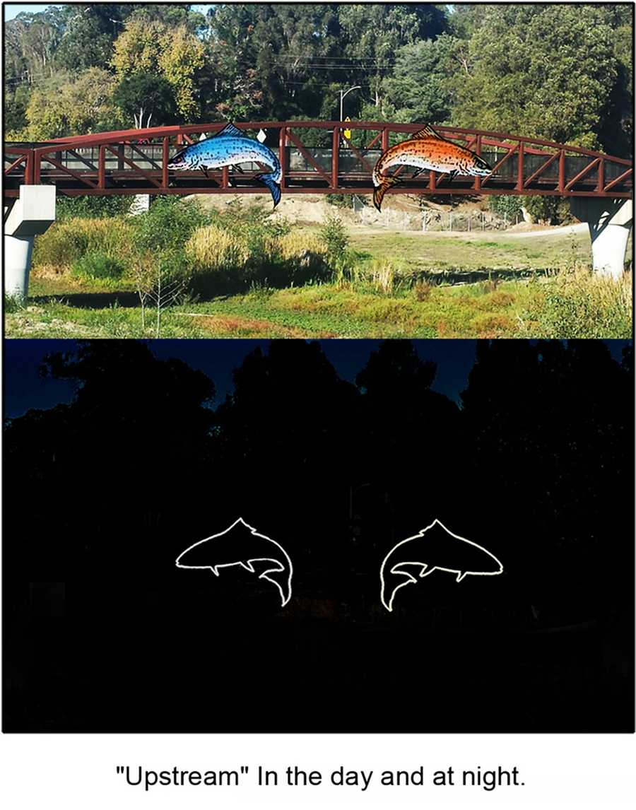 """Upstream: Kirby Scudder for """"Upstream"""" – Lit sculptures of Coho Salmon and Steelhead Trout on the side of the bridge. The purpose is to inform the public about the challenges facing wildlife in the San Lorenzo River."""