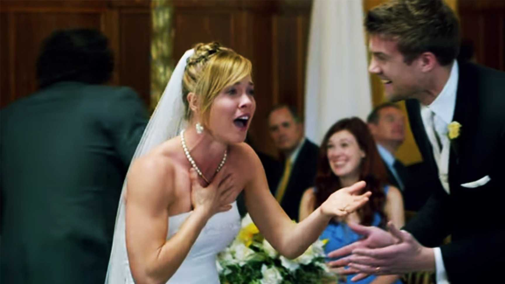 A bride can't believe her eyes when she sees Maroon 5 at her wedding.