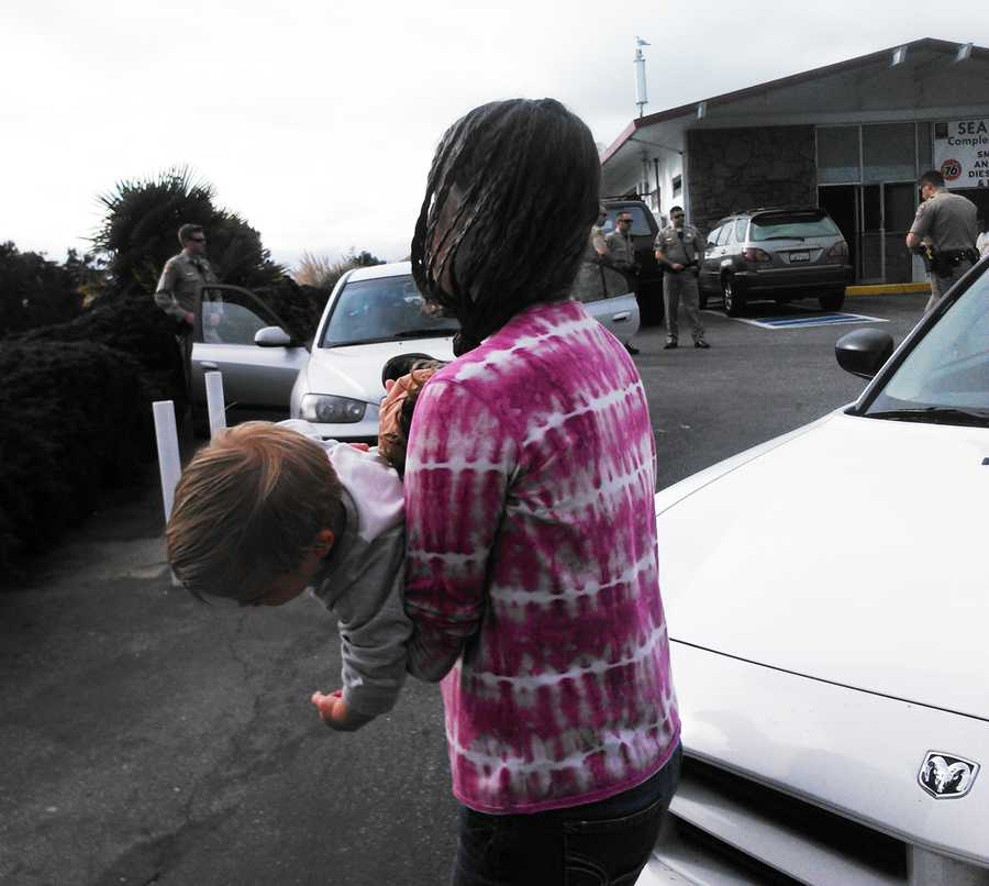 Erica Carey played with her son and two babies in the 76 station's parking lot. When Santa Cruz County CPS arrived to take custody of the three children, the mother became emotionally distraught and combative.