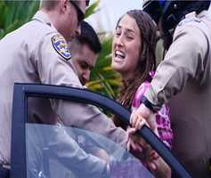 "Carey was screaming ""Jesus! Help! They are taking my children! I want my babies,"" while CHP officers put her in handcuffs."