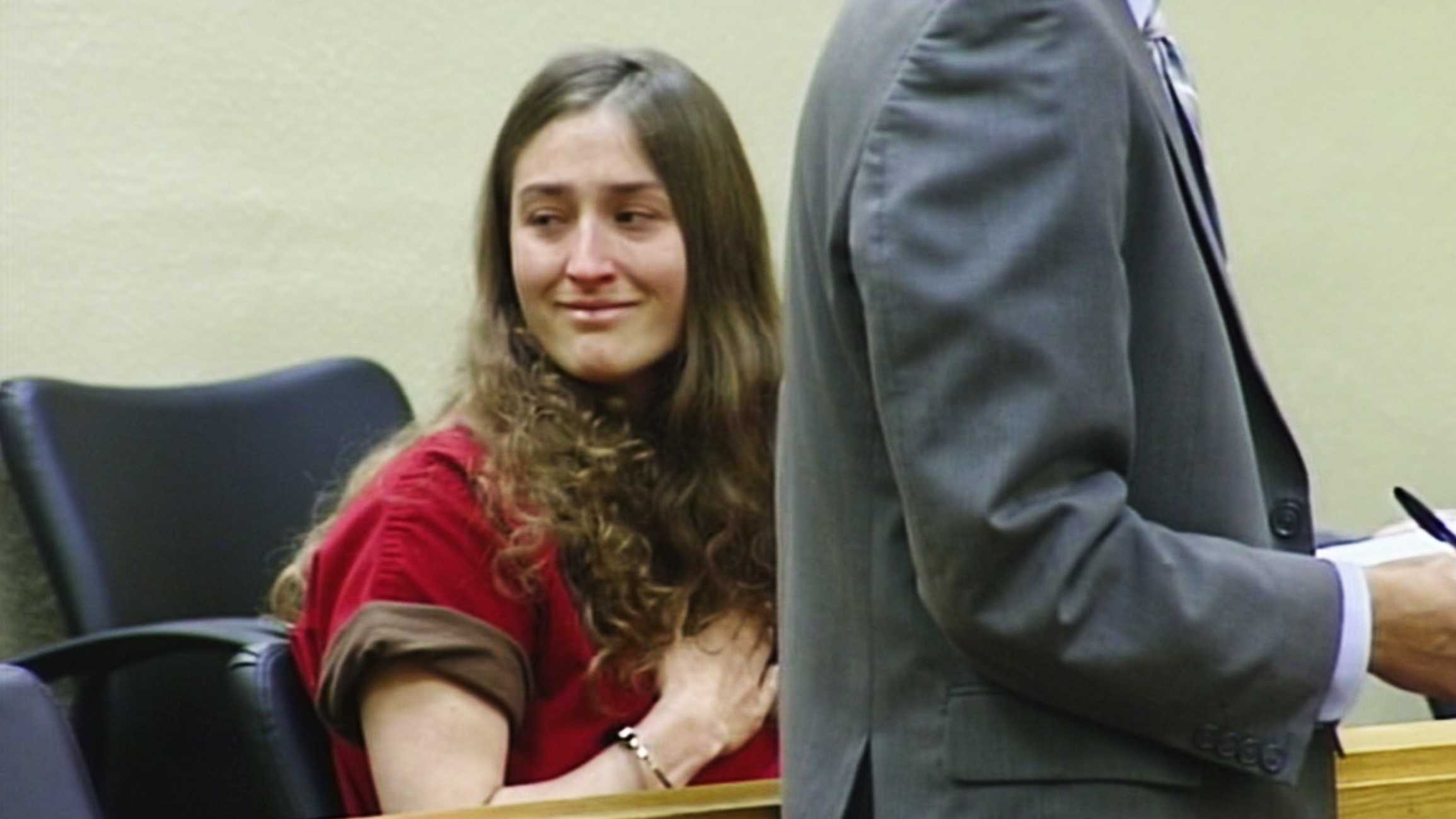 "Erica Carey smiled at Cleve Goheen-Rengo and said ""I love you,"" as she was arraigned in a Santa Cruz courthouse. (Feb. 9, 2015)"