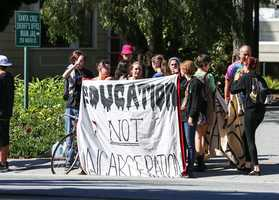 "A banner reads, ""Education Not Incarceration."" Students said the state is funneling too much money into prisons, and not enough into higher education. (March 3, 2015)"