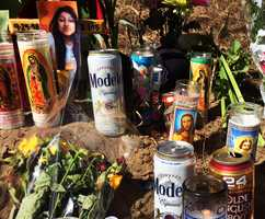 Mourners left cans of beer among prayer candles at a memorial. CHP officers said it appears alcohol or drugs were likely a factor in the collision, and open containers of alcohol were found in the car.