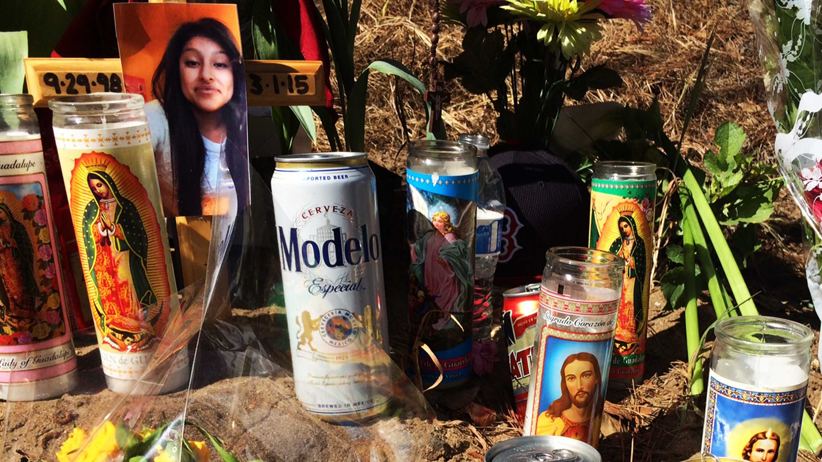 Beer cans were left among prayer candles where four died in Aptos.  (March 4, 2015)