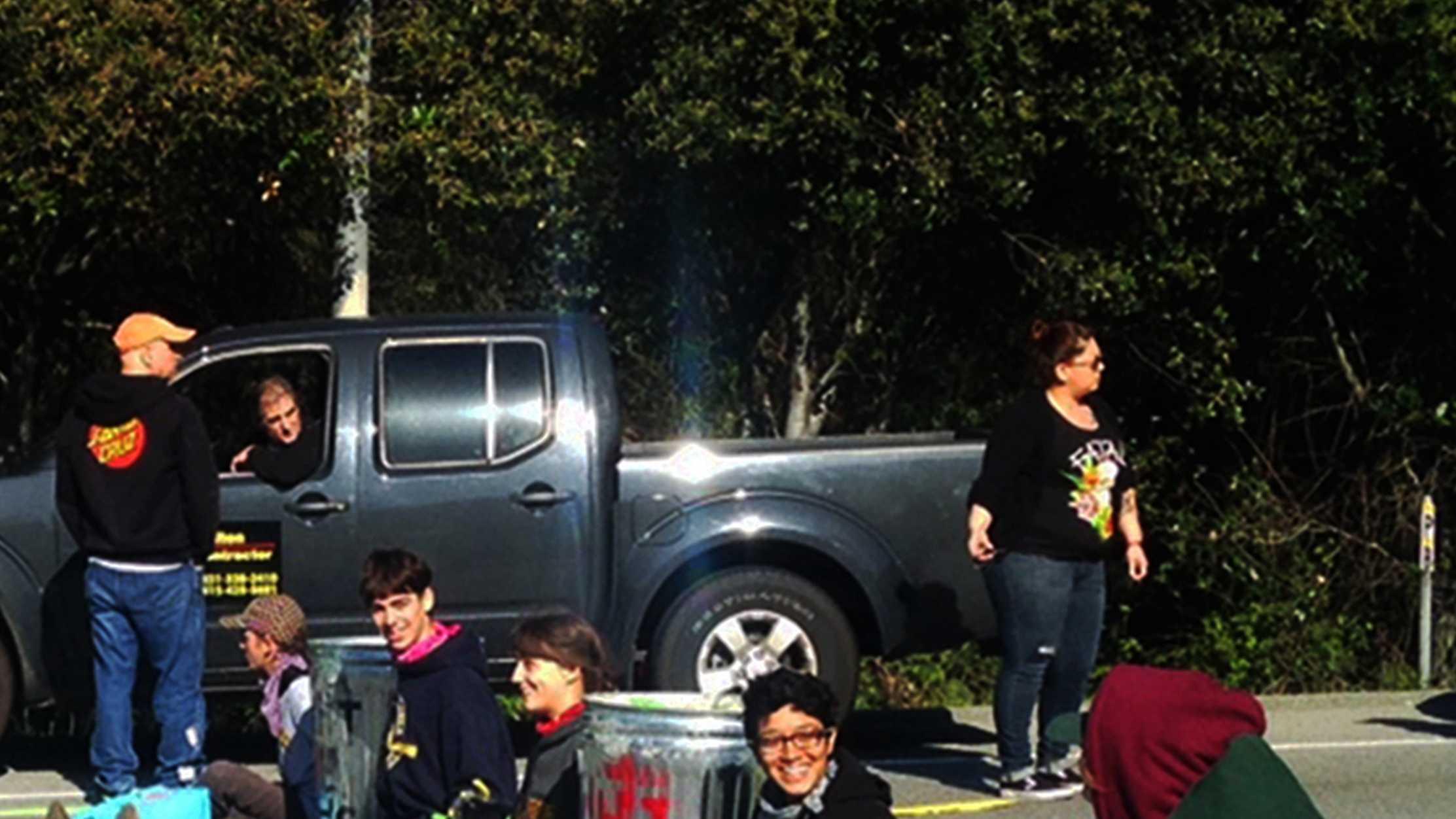 UC Santa Cruz students smile as they shut down Highway 1 with a human blockade.
