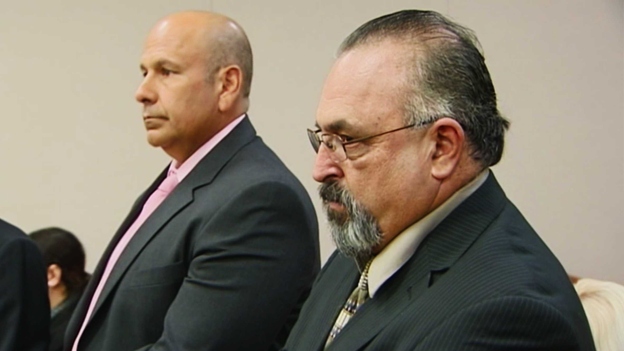 Mario Mottu, right, pleaded no contest to embezzlement. Former longtime police chief Nick Baldiviez is seen on the left. (March 25, 2015)