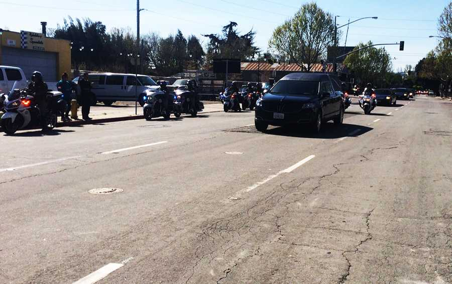 Officer Michael Johnson's casket arrives in San Jose for the funeral.