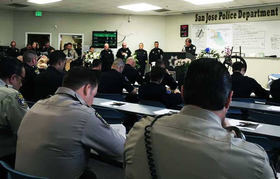 """Early Thursday morning Morgan Hill police officers were briefed at the San Jose police station before they went out to patrol the city. """"MHPD working in San Jose today to watch the city while our brothers and sisters honor Officer Johnson at SAP Center,"""" Morgan Hill police wrote on their Facebook page."""