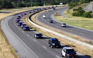 Monterey County police departments honored fallen San Jose Police Department Officer Michael Johnson with a procession along Highway 101. They passed through San Juan Bautista, Gilroy, and Morgan Hill on their way to Johnson's funeral.