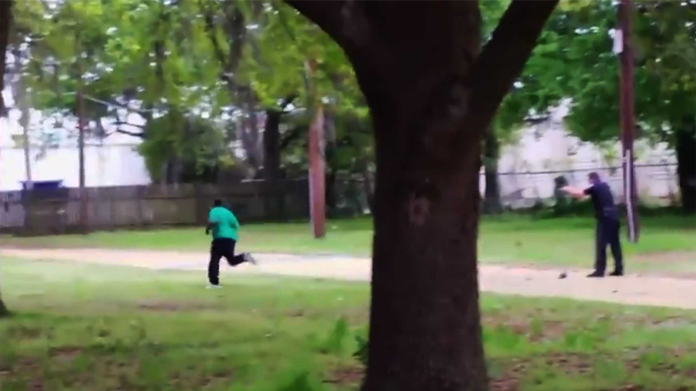 Officer Michael Slager, right, is seen here shooting a feeling, unarmed man to death.