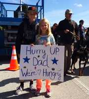 Maggie and Mason Butier root for their dad.
