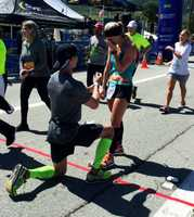 Cody Moss proposed to his girlfriend Candy Collins at the marathon finish line.