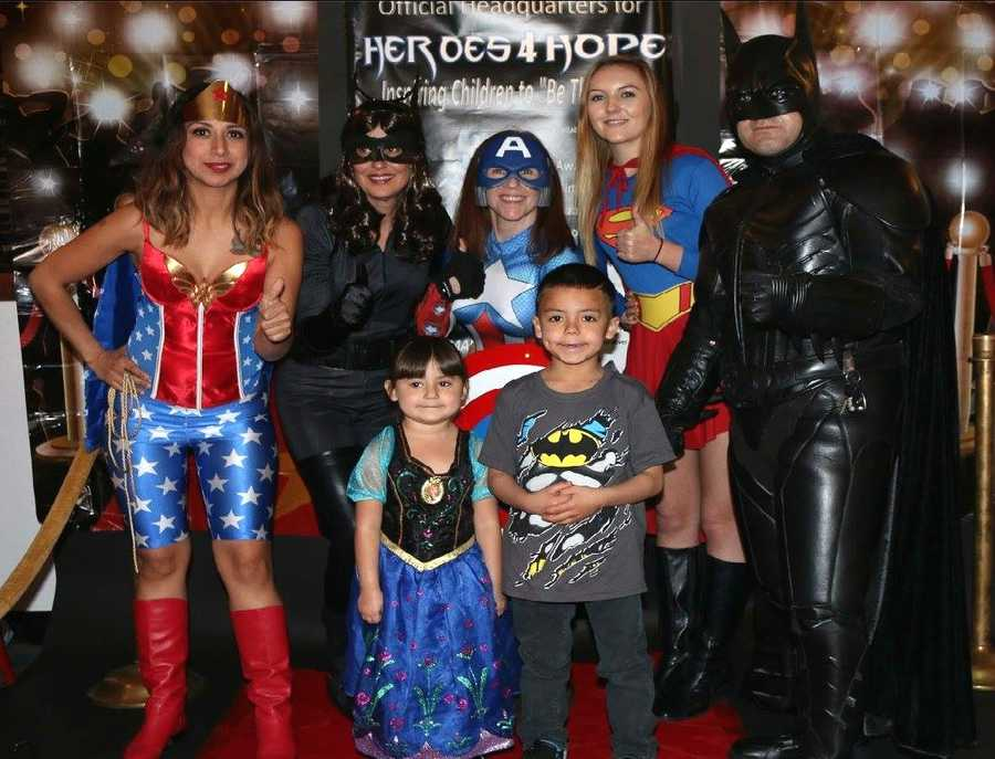 """I love working for Heroes4Hope because we get to send a positive and uplifting message to children, teaching them that they can all be heroes,"" said Tori Rowe, who dresses as Superwoman."