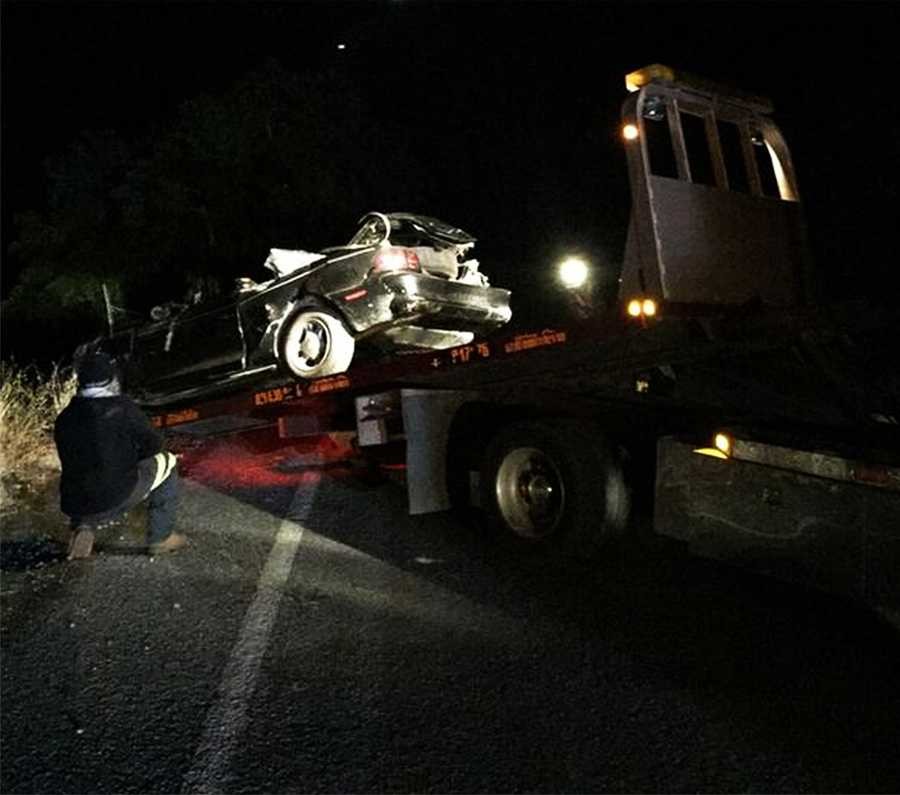 This Ford Mustang was reduced to a mangled heap of metal at the bottom of a 20-foot ravineat the intersection of Leavesley Road and New Avenue in Gilroy. (May 12, 2015)