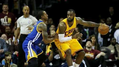 LeBron James drives against Andre Iguodala.