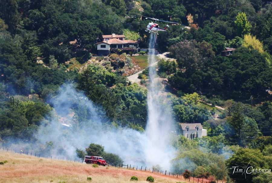 CalFire air units quickly swooped in dropping retardant and contained the blaze by 12:55 p.m.